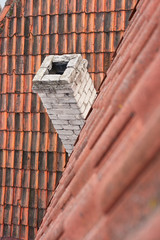 Tile roof and chimney.