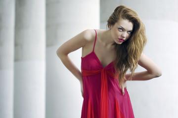 Fashion model posing in dress outdoors