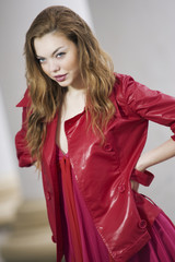Fashion model posing in jacket and dress