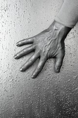 futuristic man silver hand over textured steel