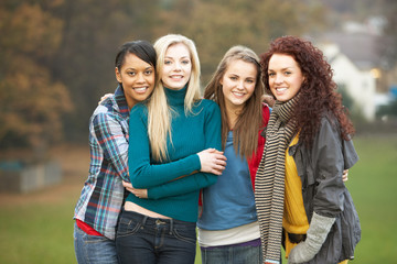 Group Of Four Teenage Girls In Autumn Landscape