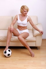 woman at home with a soccer ball