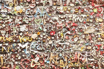 Brick wall covered with bubble gum.
