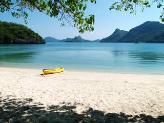 A Yellow Kayak Boat on a Beach, Thailand
