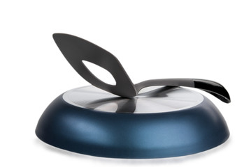 Shovel for meal lies on turned frying pan