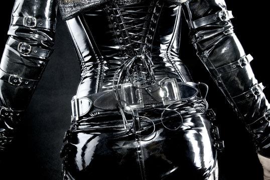 woman in black latex uniform