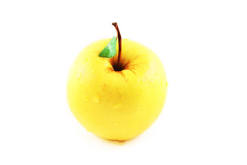 Yellow golden apple with a green leaf