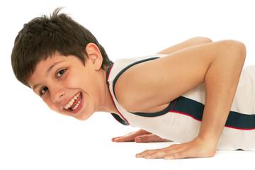Sporty boy pushing up