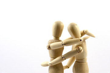 A pair of mannequins positioned into an embrace
