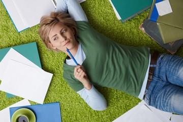 Woman thinking on floor