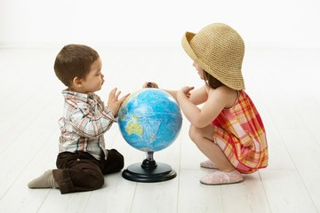 Children playing with globe
