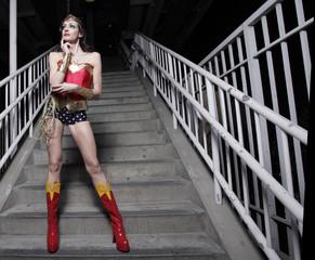 Superhero posing on a staircase