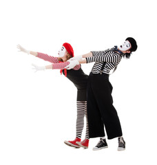 portrait of mimes in striped costumes