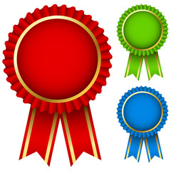 Blank award ribbon rosettes in three colors.