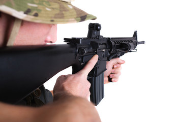 Soldier shooting rifle