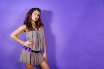 Shot of young and beautiful woman on the lilac background