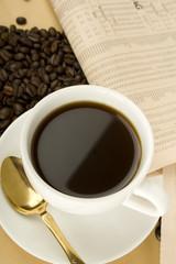Caffeine Drink & Newspaper