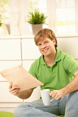 Man with coffee and newspaper