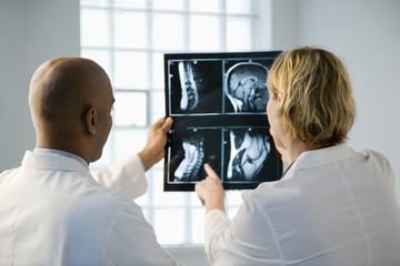 Doctors looking at xray.