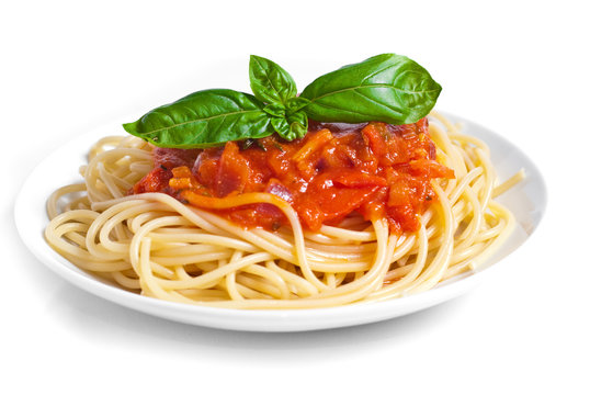 pasta tomato with basil on the top, isolated on white