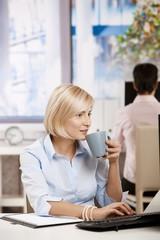Busnesswoman drinking coffee