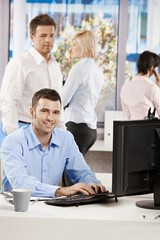 Office life - businessman working at desk