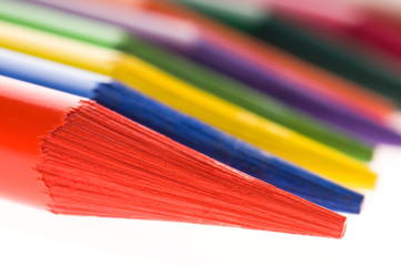 Collection of colorful pens over white background