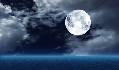 The full moon over water
