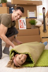 Young couple having fun at moving house