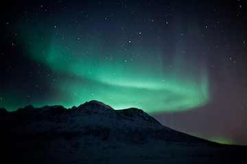 Northern Lights above a mountain
