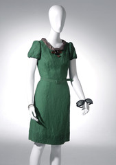 collection of females green dress on mannequin