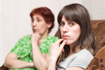 Mature woman mother and young girl daughter have fallen out