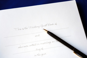 The first page of a wedding guest book isolated on blue