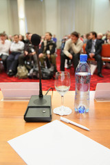 conference in hall. focus on bottle.