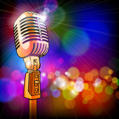 golden microphone in the light colored lights