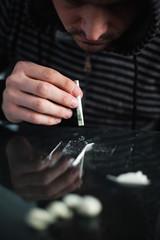 Addict snorting cocaine