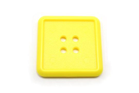 A square yellow button