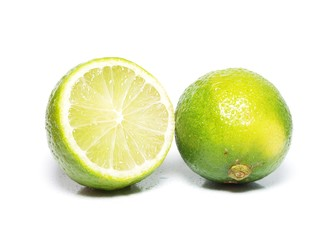 Lime fruit, one whole and a half, towards white background