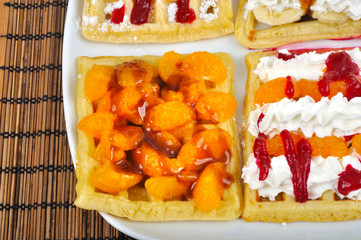 Homemade wafle with mandarin and caramel icing