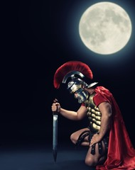 Fotorolgordijn Ridders Legionary soldier standing on a knee at night time