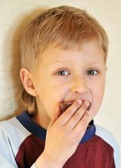 boy eating chocolate egg