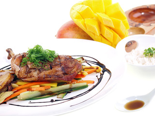 fried chicken adobo, rice and fresh mango isolated on white