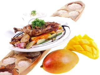 fried chicken adobo, rice & fresh mango isolated on white