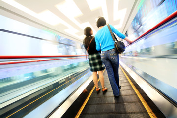 the shopper gong on the escalator in shopping. .