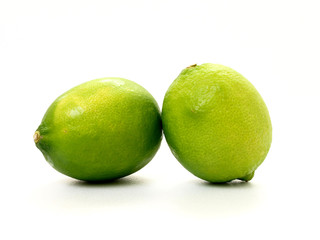 two green lime in white