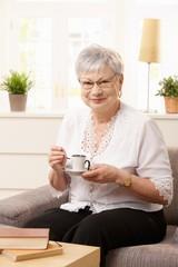 Senior woman resting on sofa