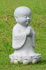 Young Buddha Statue In The Field