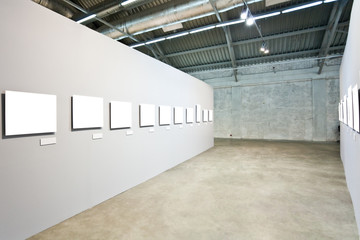 Grey walls with many frames