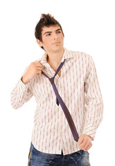 boy correcting a tie