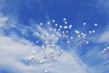 white balloons flying in sky